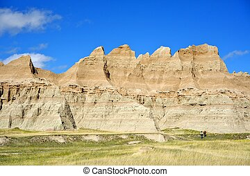 Hiking in the Badlands - Two Hikers on Badlands Trail. Badlands National Park USA