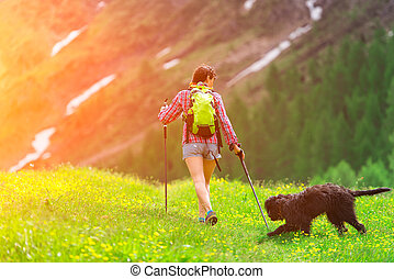 Hiking in the mountains with his dog
