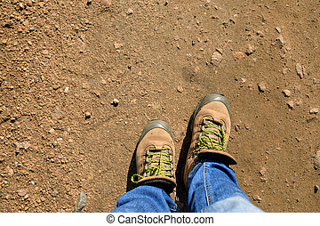 hiking legs on the dirt trail