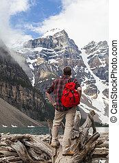 Hiking Man Looking at Moraine Lake & Rocky Mountains