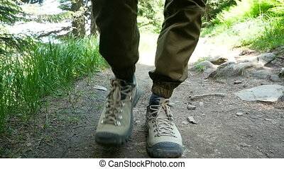 Hiking mountain feet boot - Following hikers climbing the ...