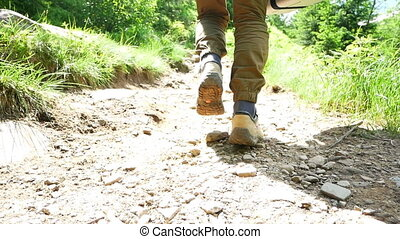 Hiking mountain feet boot - Following hikers climbing the...