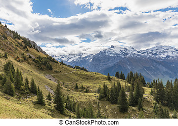 Hiking on mount Brunni at Engelberg in the Swiss alps in...