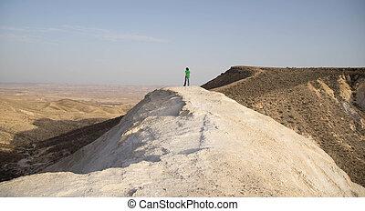 Hiking people in desert