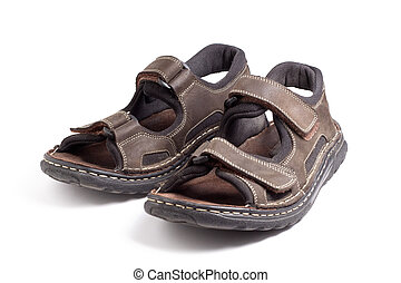 A pair of leather hiking sandals isolated on a white background