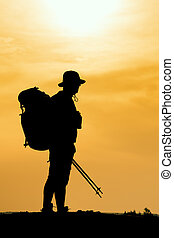 Hiking silhouette in mountains