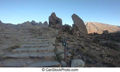 Hiking spectacular volcanic landscape surrounding Roques de...