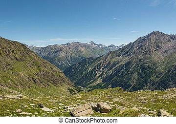 Hiking through spectacular mountain landscape of Gran Paradiso Natural Park.