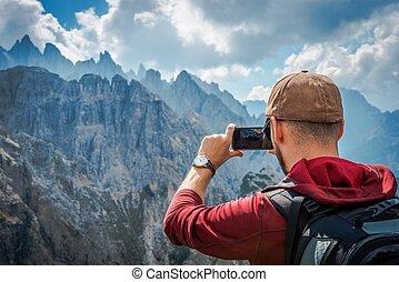 Hiking Tourist Taking Photos