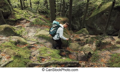 Hiking with Obstacles - Fair-haired, athletic boy...