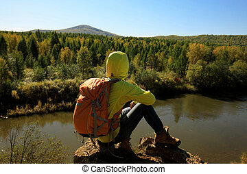 hiking woman enjoy the view in the autumn forest