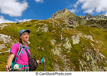 Hiking woman happy to be in the mountains