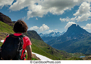 hiking woman looking a Pic du Midi Ossau in  french Pyrenees mountains