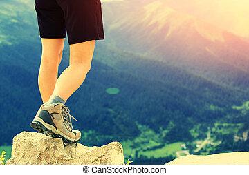 hiking woman on mountain peak