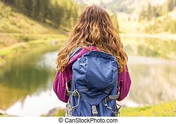 HIking woman watching the lake view in Switzerland
