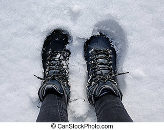 hikking boots in the snow