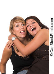 Hilarious laughter - Two sisters having fun together,...