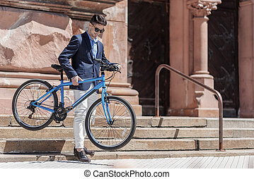 Hilarious smiling male person holding bike - Cheerful man...