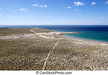 Landscape from the hill on the beach after Punta Loma near Puerto Madryn, a city in Chubut Province In Patagonia, Argentina. Puerto Madryn is protected by the Golfo Nuevo, which is formed by the Peninsula Valdes and the Punta Ninfas