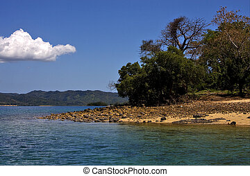 hill navigable froth cloudy lagoon and coastline in madagascar nosy be