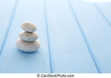 Hill of gray stones on a beautiful table