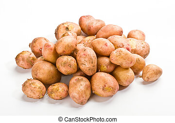 hill of new potatoes over white background