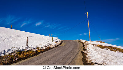 Hill on a country road in rural Lancaster County,...