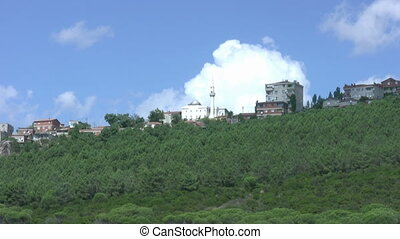 Hill town with cloudscape