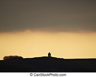 Hill with a small Church Sunset Silhouette