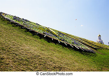 Hill with flower clock