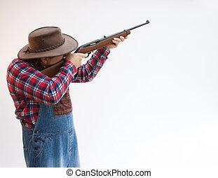 Hillbilly or farmer taking aim. - Hillbilly or farmer taking...