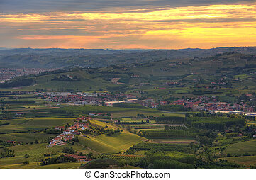 Hills and vineyards at sunrise in Italy. - Aerial view of...