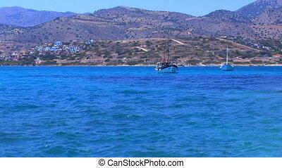 Hills, Boats and Road on the sea shore, Crete