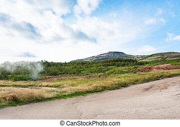 hills near in Haukadalur hot spring area in autumn - travel...