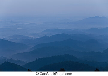 Hills on a colorful misty morning in Chiang Rai,Thailand