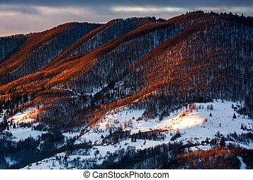 hillside in red light on winter sunrise. beautiful nature...
