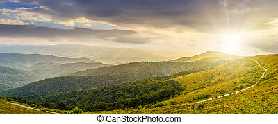 hillside panorama in mountains at sunset - panoramic summer...