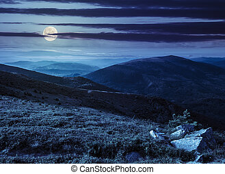 hillside with stones in high mountains at night - view on...