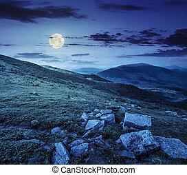 hillside with white stones at night - white sharp stones in...
