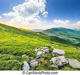 hillside with white stones at sunrise - white sharp stones...