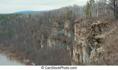 Hilltop overlooking the river surrounding a huge forest a...