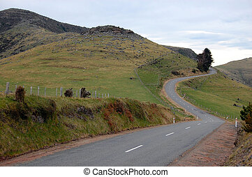 Hilly road and fence