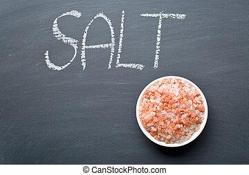 Himalayan salt on blackboard