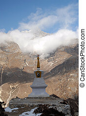 Stupa - Himalayan Stupa with mountains in the background
