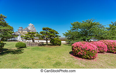 Himeji castle on top of the hill and gardens - Himeji castle...
