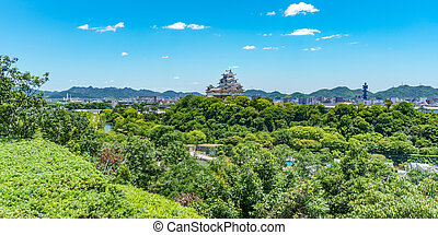 Himeji castle on top of the hill over the city - Panoramic...