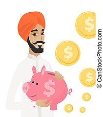 Hindu businessman holding a piggy bank.