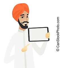 Hindu businessman holding tablet computer.