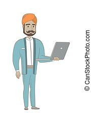 Hindu businessman using laptop.
