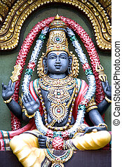 Image of a Hindu diety sculptured out of stone.